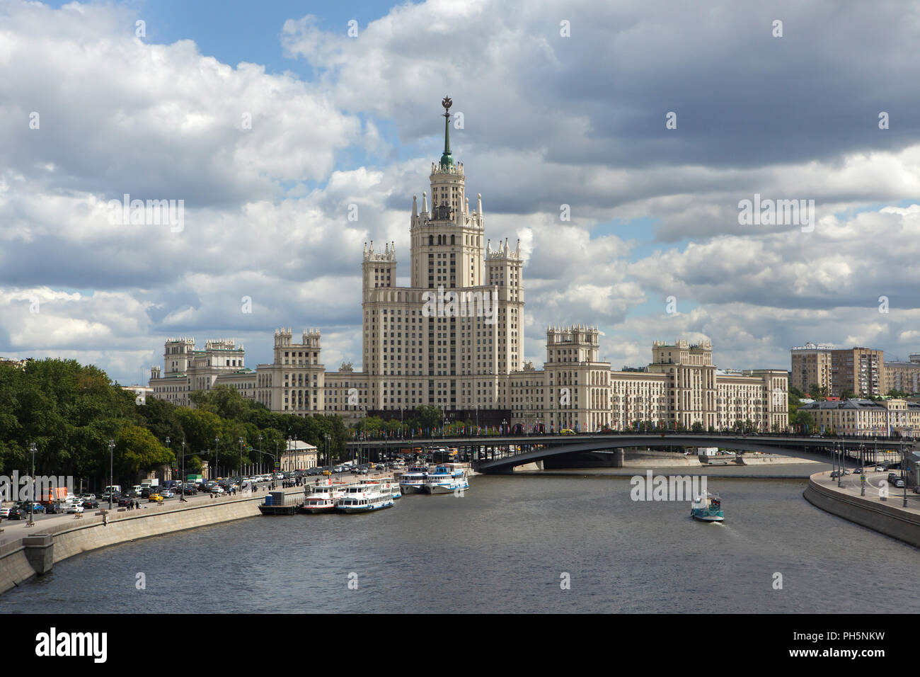 Kotelnicheskaya Embankment Building and the Moskva River pictured from the Floating Bridge in Zaryadye Park in Moscow, Russia. One of the seven Stalinist skyscrapers was designed by Soviet architects Dmitry Chechulin and Andrei Rostkovsky and built in 1947-1952. - Stock Image