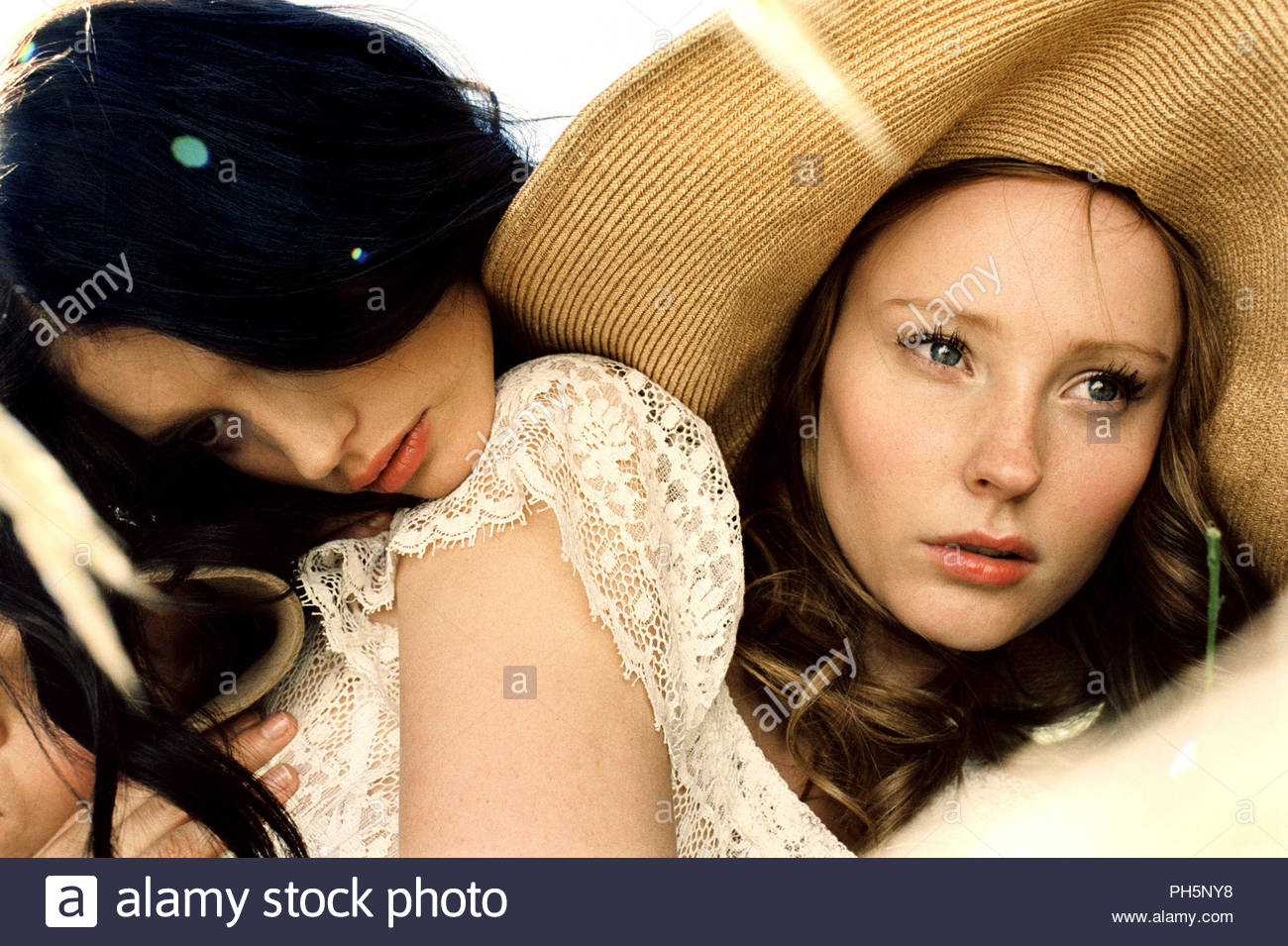 Young woman leaning on her friend - Stock Image