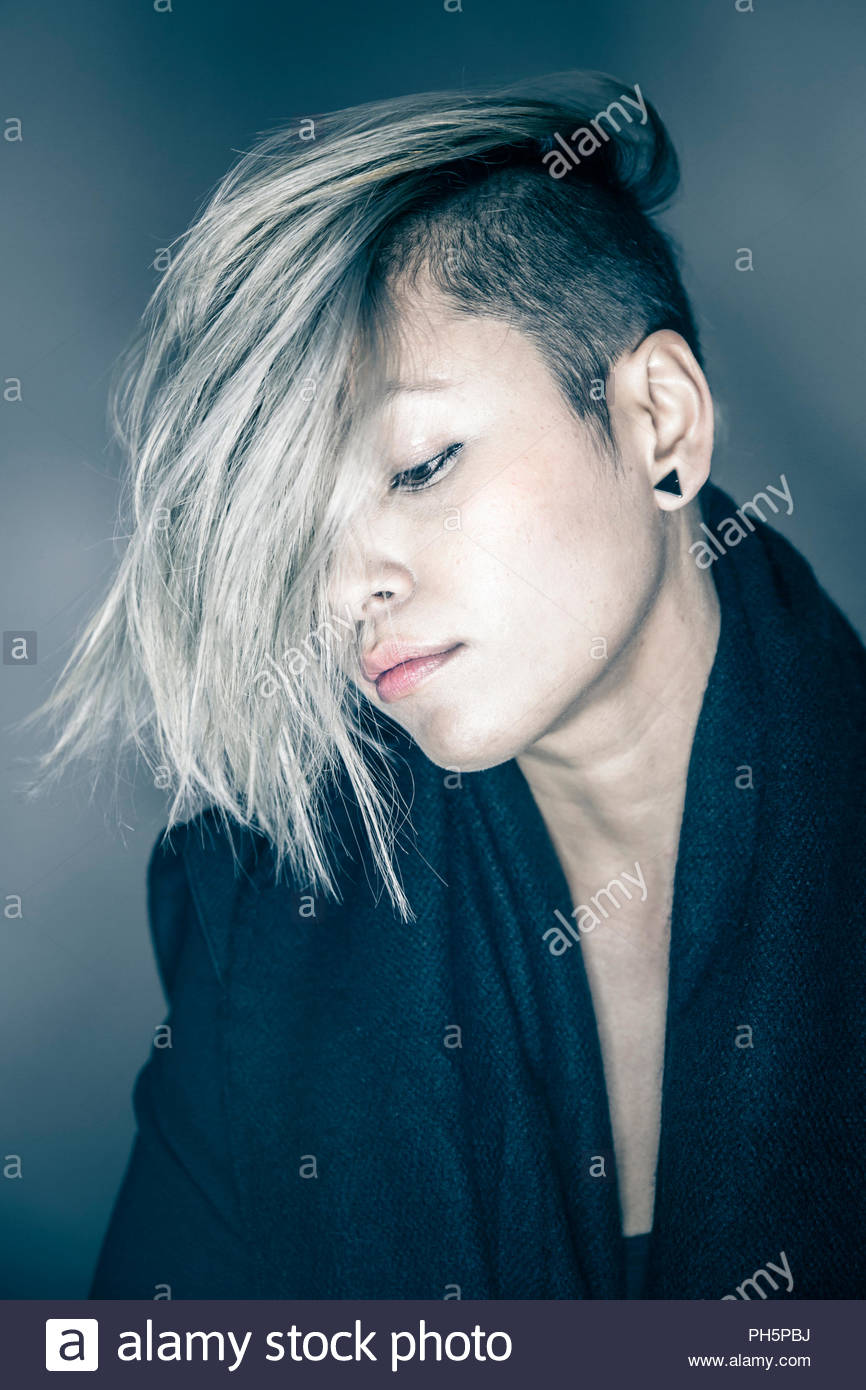 Young woman with her hair covering her face - Stock Image