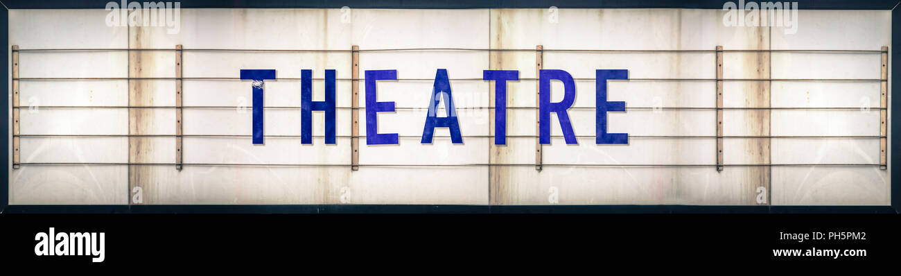 A Grungy Old Weathered Theatre Marquee Sign With Blue Letters - Stock Image