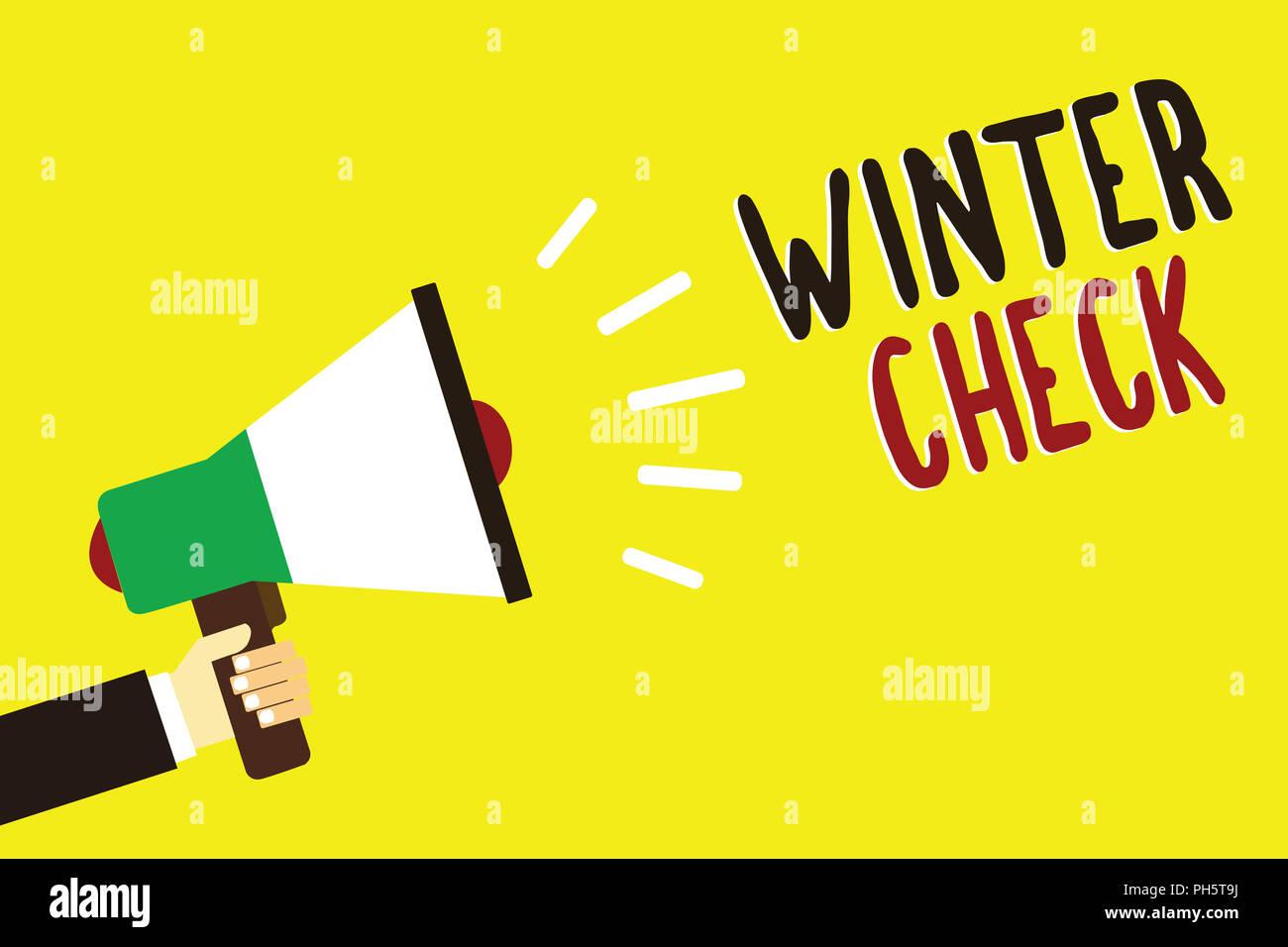 Text sign showing Winter Check. Conceptual photo Coldest Season Maintenance Preparedness Snow Shovel Hiemal Man holding megaphone loudspeaker yellow b - Stock Image