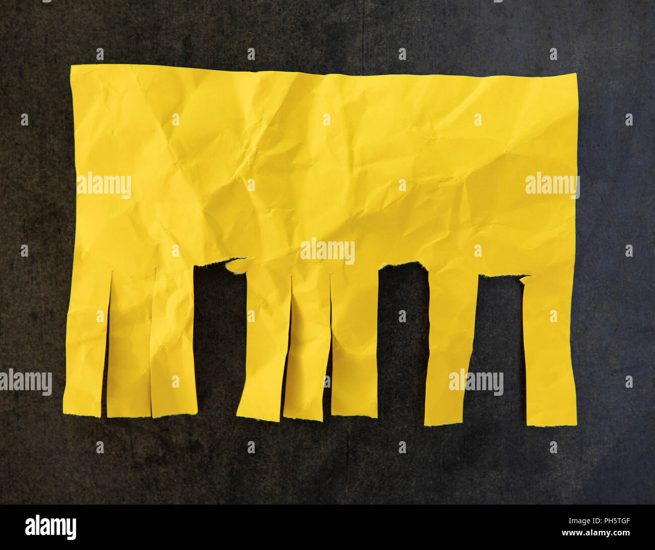 Blank yellow paper with tear off tabs - Stock Image