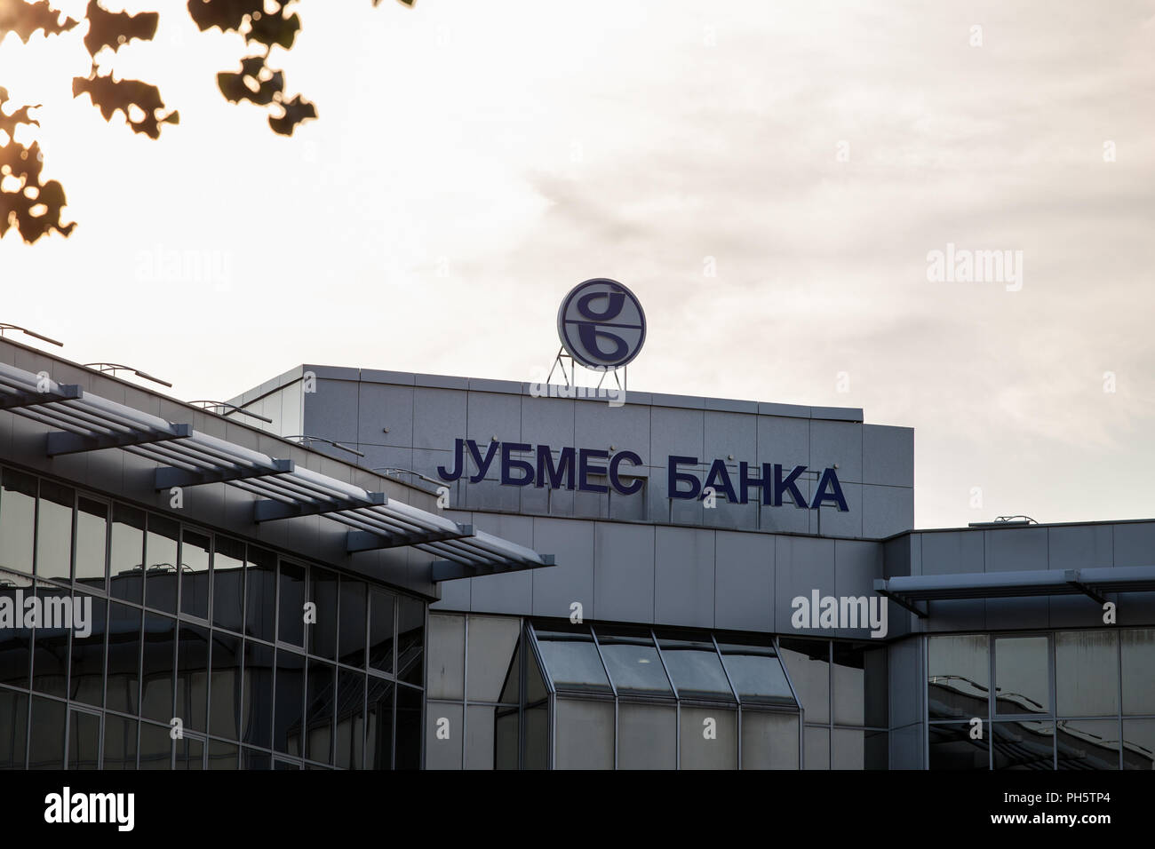BELGRADE, SERBIA - AUGUST 21, 2018: Jubmes Banka logo on their main office in Belgrade. Jubmes banka is a Serbian bank, providing commercial and inves - Stock Image