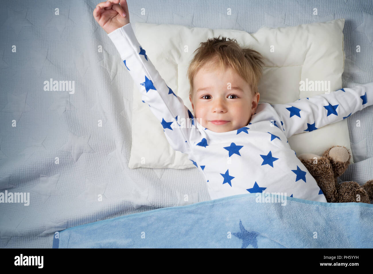 three years old child sleeping in bed - Stock Image