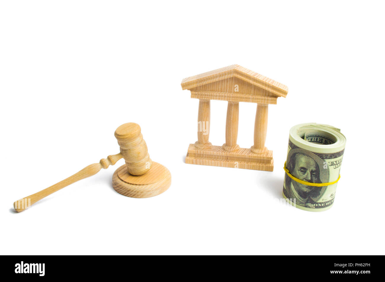 wooden government building Judge's hammer and money, on a white background. concept of state administration and economic institutions. Municipality, g - Stock Image