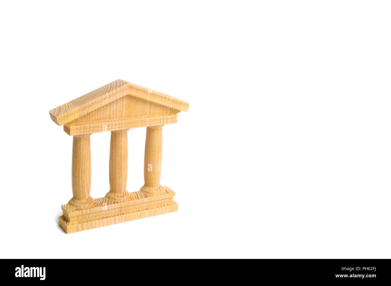 State Building. wooden government building Judge's hammer and money, on a white background. concept of state administration and economic institutions. - Stock Image