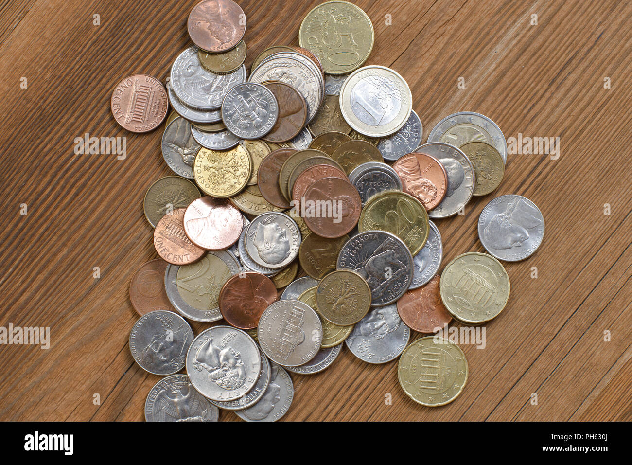 Money on old wooden surface copyspace ready for edit as money themed cover - Stock Image