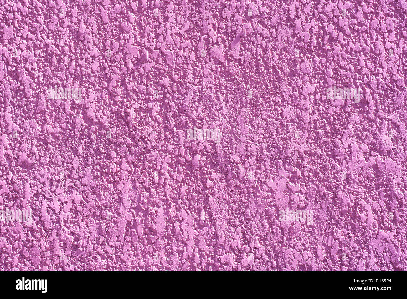 Scabrous textured pink background. Bright background. Close-up - Stock Image