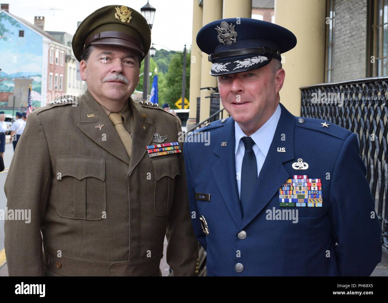 Brig. Gen. Michael Regan, Pa. deputy adjutant general-air (right), rubs shoulders with Gen. Carl Spaatz re-enactor Chris Boswell following a road dedication ceremony in Boyertown, Pa. June 28, 2018. Spaatz, the first Chief of Staff of the newly formed Air Force following the enactment of the National Security Act of 1947 grew up in Boyertown and is touted as one of their greatest citizens. - Stock Image