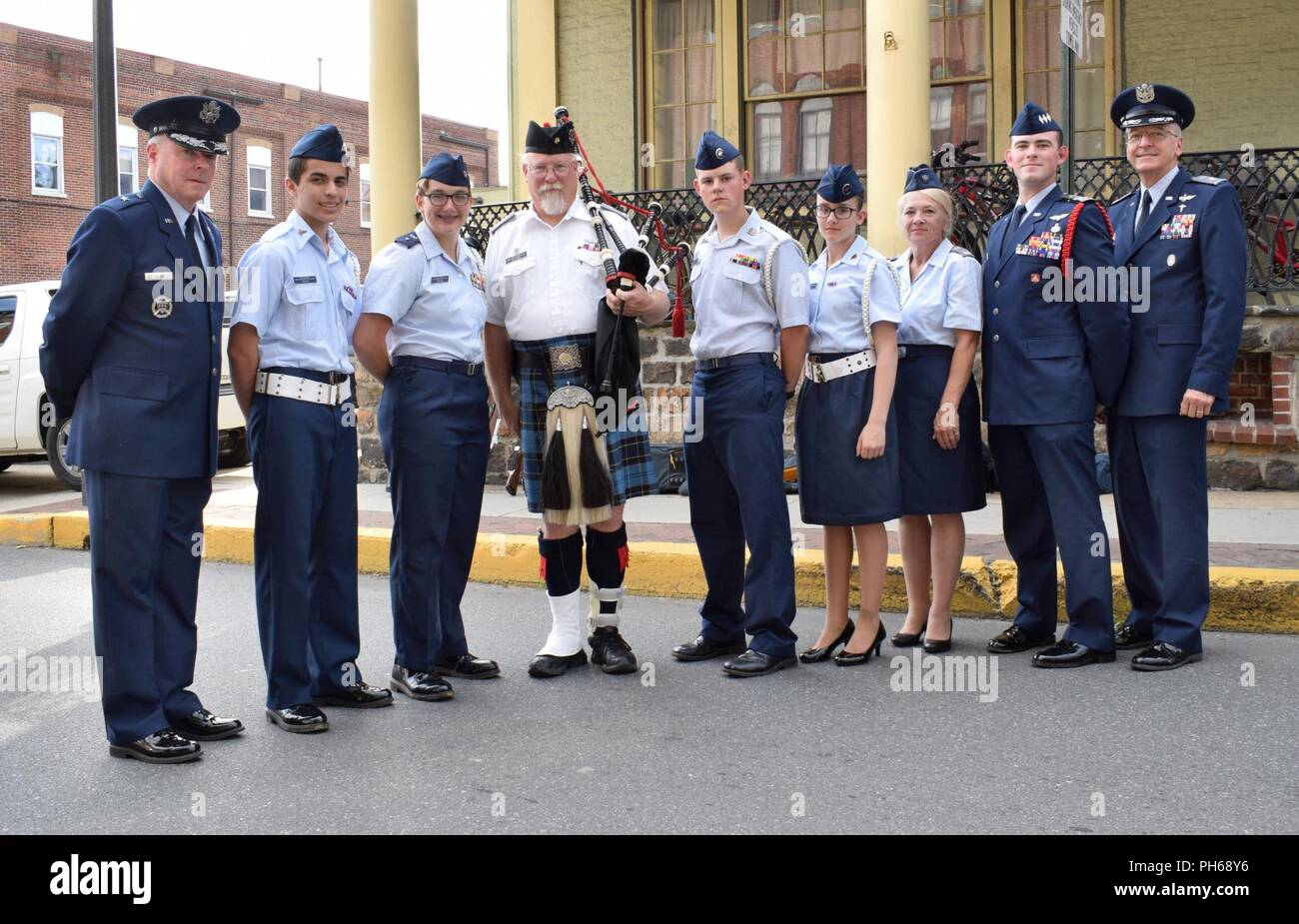 Following a roadway dedication ceremony in Boyertown Pa., June 28, 2018, Brig. Gen. Michael Regan, Pa. deputy adjutant general-air (left) posses with members of the Commander Gen. Carl A. Spaatz Composite Civil Air Patrol Squadron from Limerick, Pa. The young Cadets opened the event with the Presentation of the Colors and provided the backdrop during Regan's keynote speech during the gathering. - Stock Image