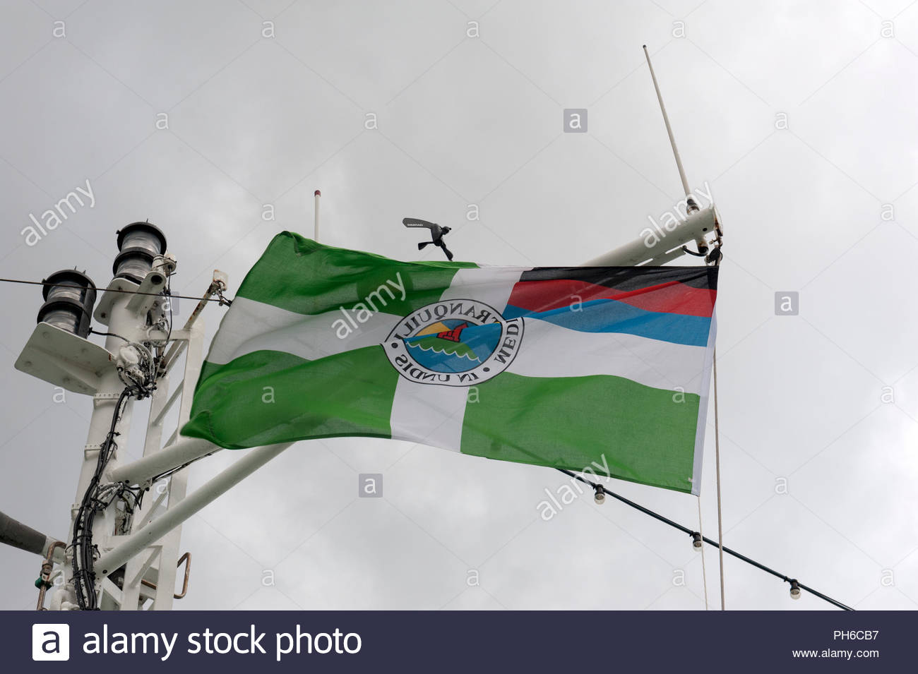 Borkum Germany Borkumer flag on ship flying in stormy winds. Stock Photo