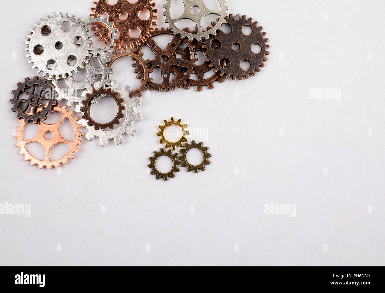 Different sizes and colored gears on a white background - Stock Image