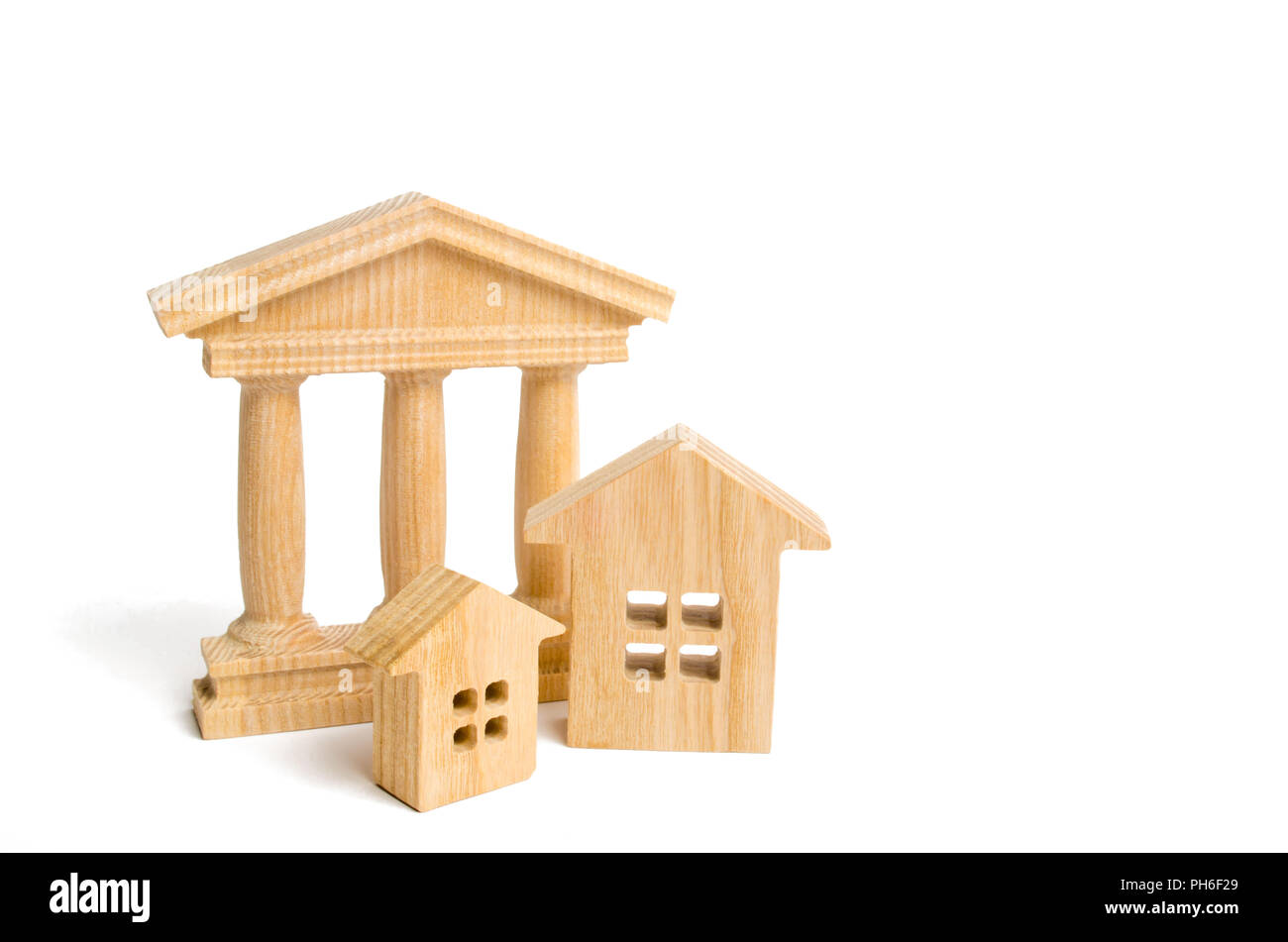 Wooden figures of buildings and a pantheon. Concept of urban structure and standardization. The role of government in society. Banking system, investm - Stock Image