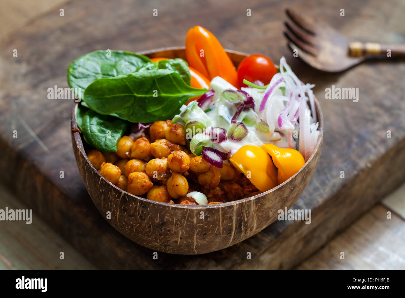 Vegan Buddha bowl with spicy chickpeas - Stock Image
