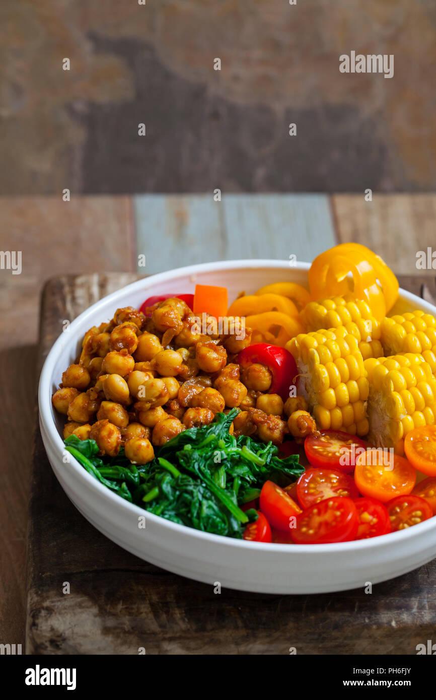 Vegan Buddha bowl with spicy chickpeas - Stock Image