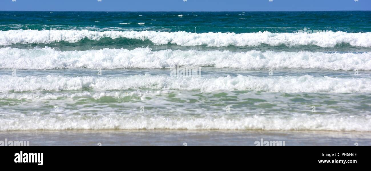 Waves rolling in on Riviere Towans beach, Phillack, Hayle,cornwall,England,UK - Stock Image