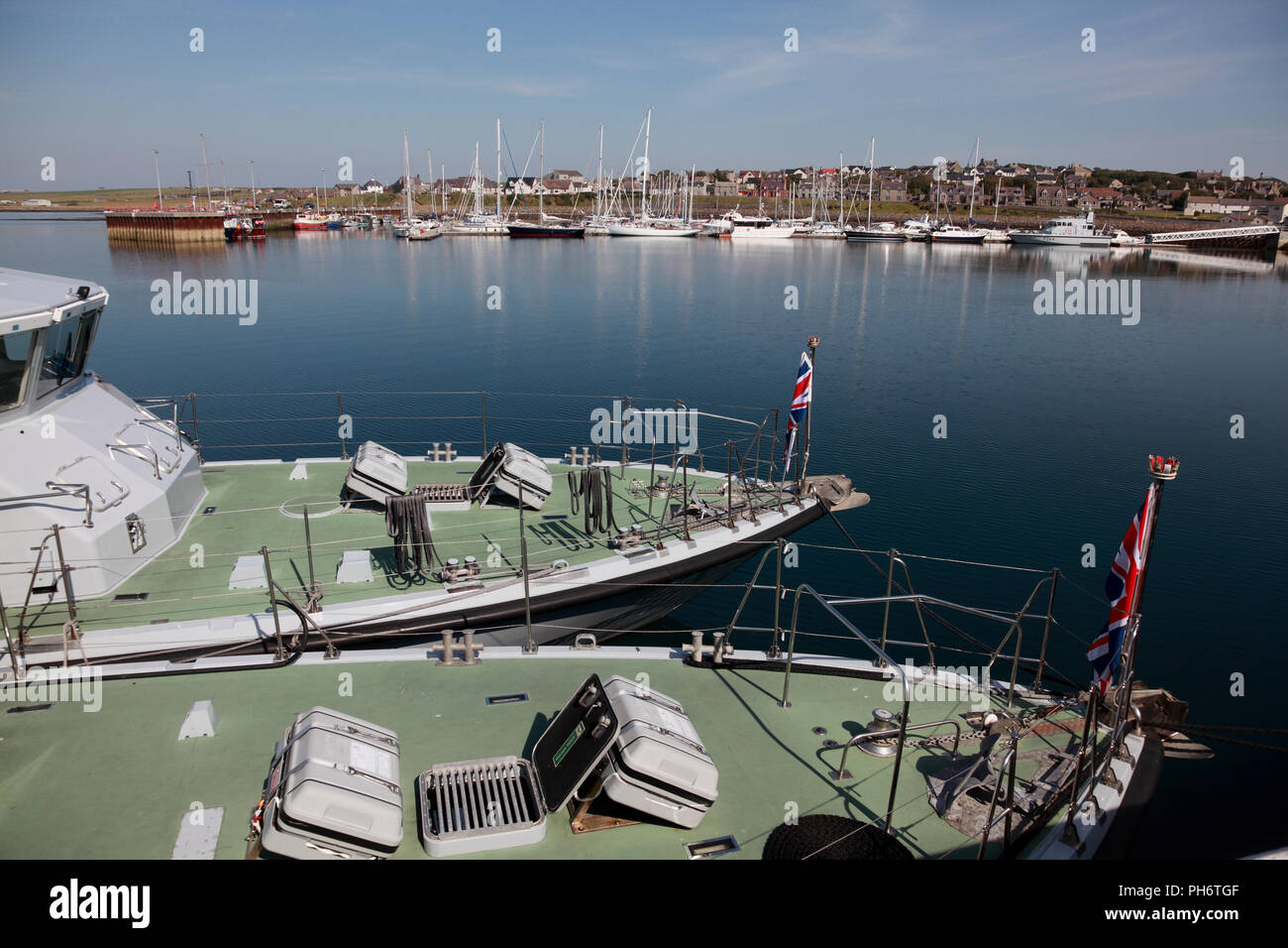 Boats in Kirkwall harbour, including Archer class Royal Navy fast training boats in the foreground, Orkney, Scotland - Stock Image