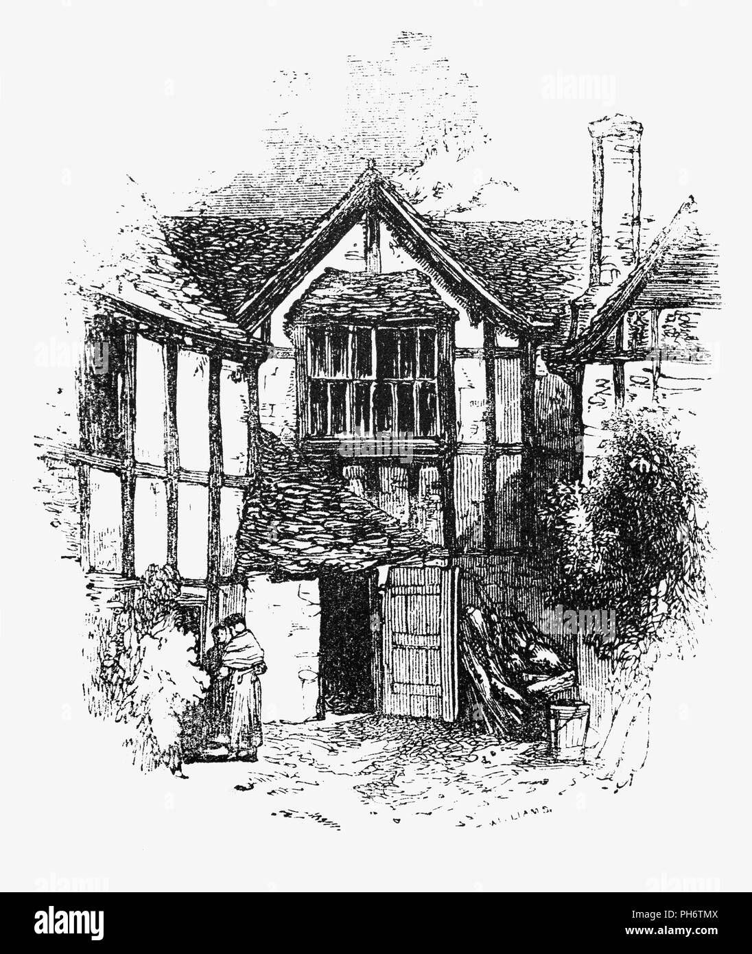 A Tudor house courtyard in Evesham, a market town in Worcestershire, England In a typical Tudor house the weight of the house was carried on a wooden frame. The space between the wooden beams was filled in with either brick or plaster. Brick was costly so plaster was used as the infill between the beams in smaller houses. The plaster was whitewashed, giving houses their distinctive black-and-white appearance. - Stock Image