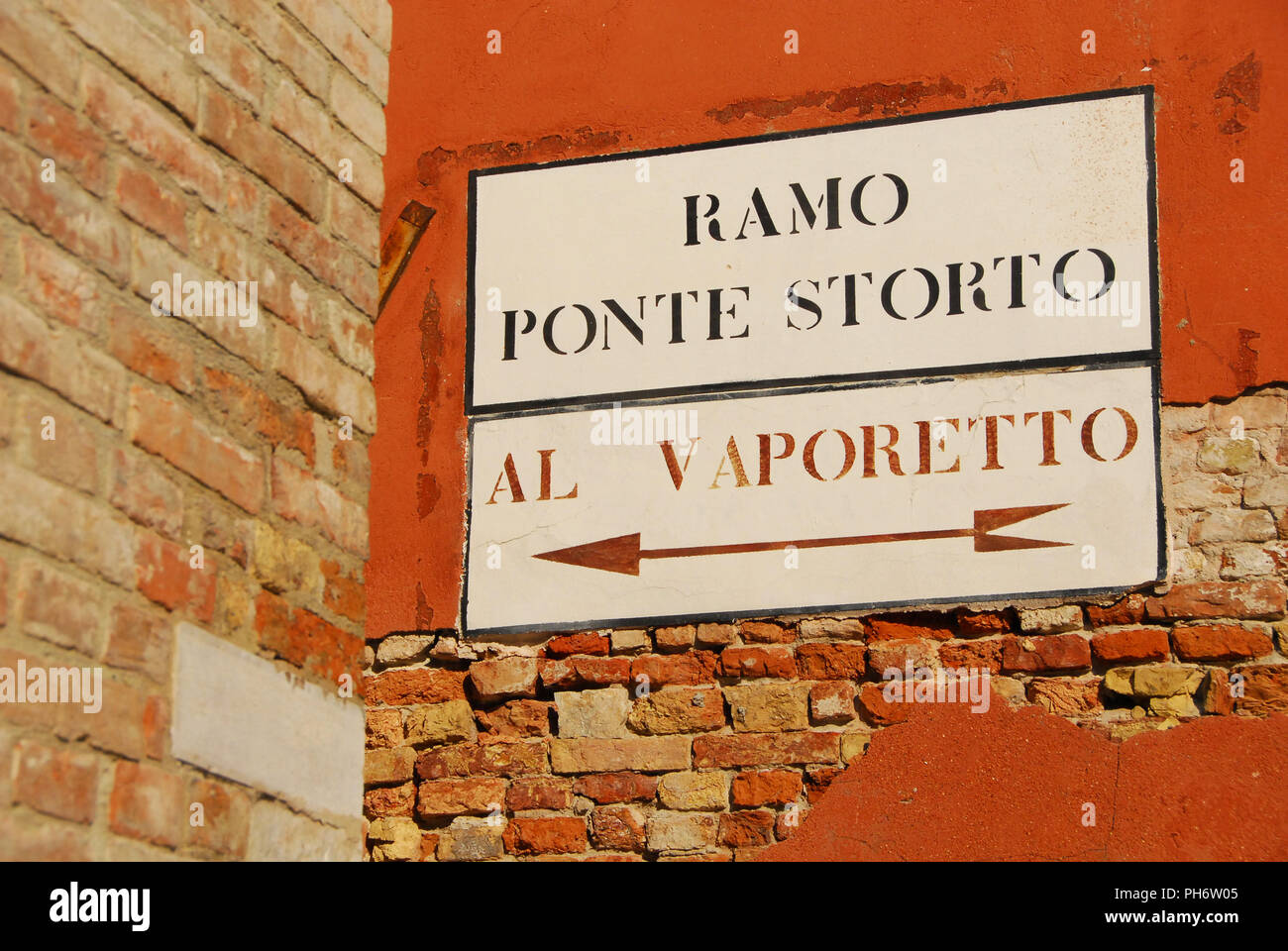 'Vaporetto' (venetian water bus) old traditional road sign on a wall in Venice - Stock Image