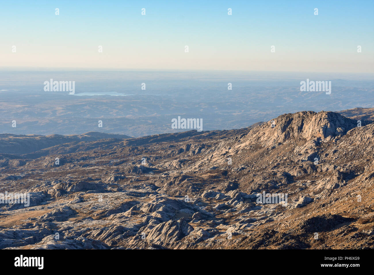 Sunny day from the top of the mountain and with a beautiful view. After a long walk the landscape rewards the effort. - Stock Image