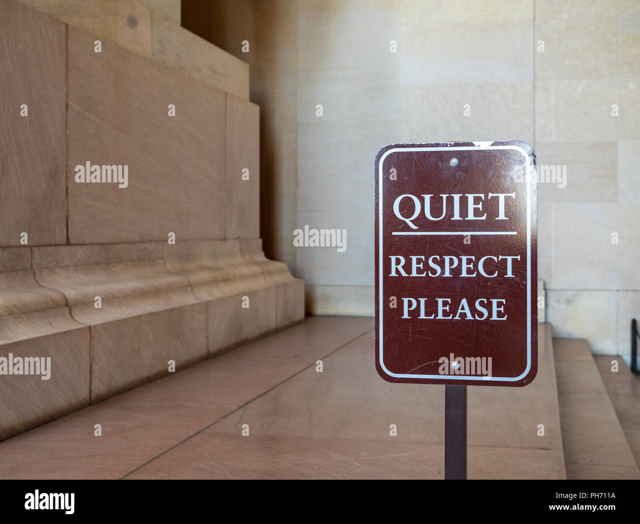 Quiet, respect please brown sign in front of a decorative display - Stock Image