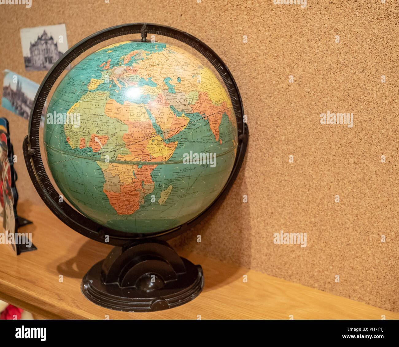Rustic world globe displaying Africa and Europe in a child's room - Stock Image