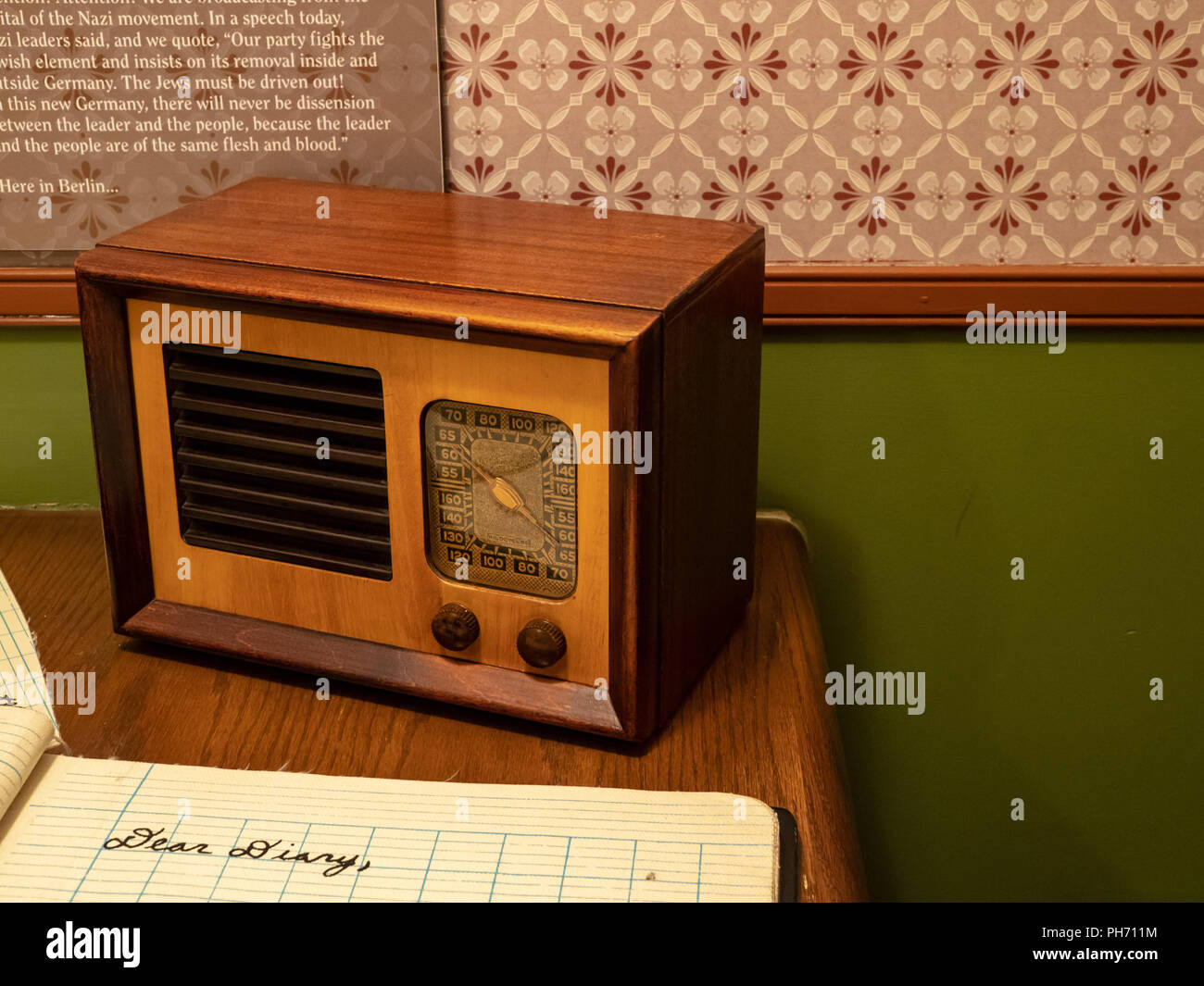 Antique transistor radio sitting in a child's room with a diary Stock Photo