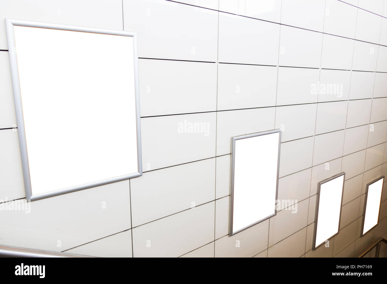 Four big vertical / portrait orientation blank billboard with stairs background - Stock Image
