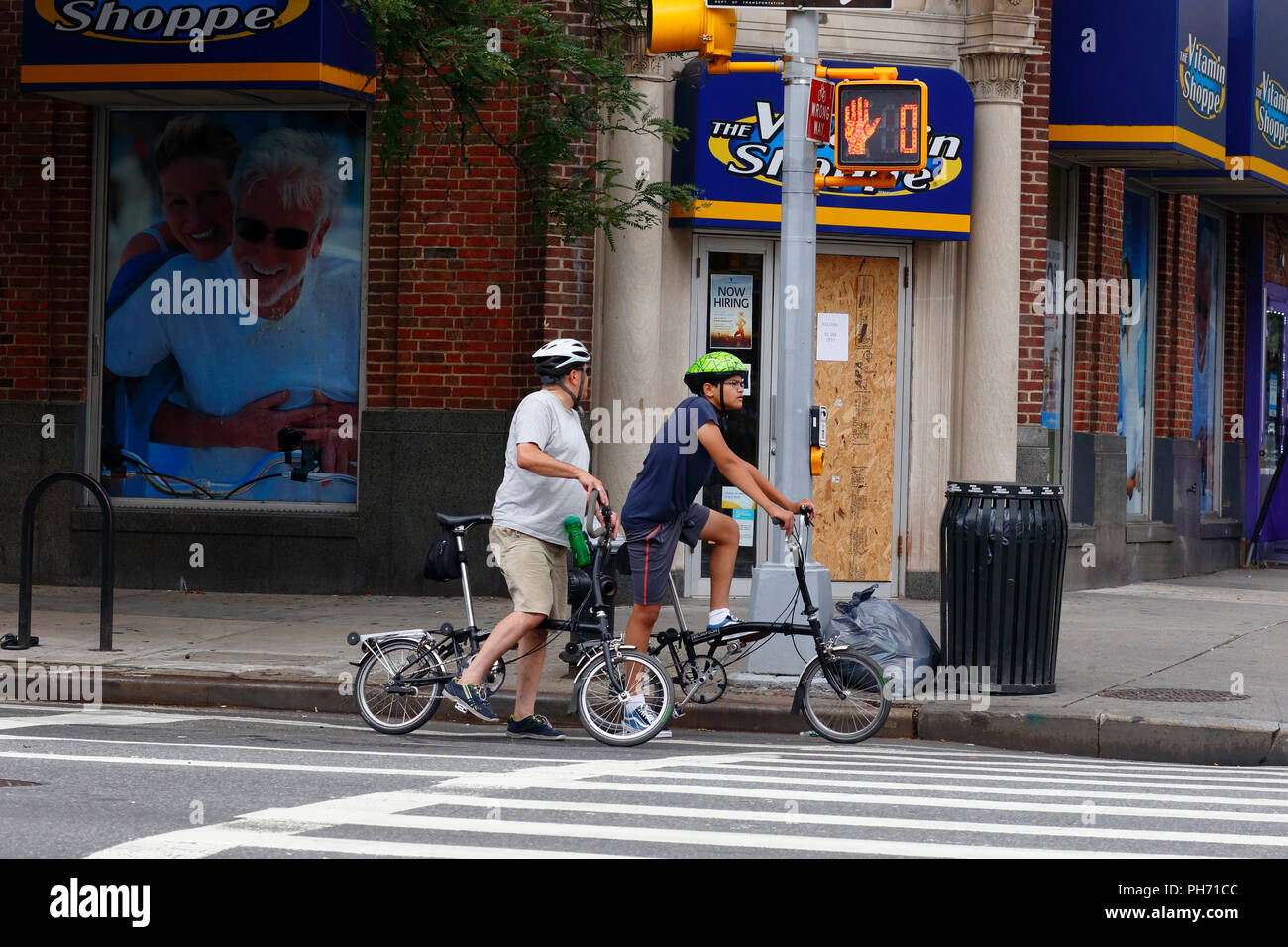 Cyclists on Brompton folding bicycles - Stock Image