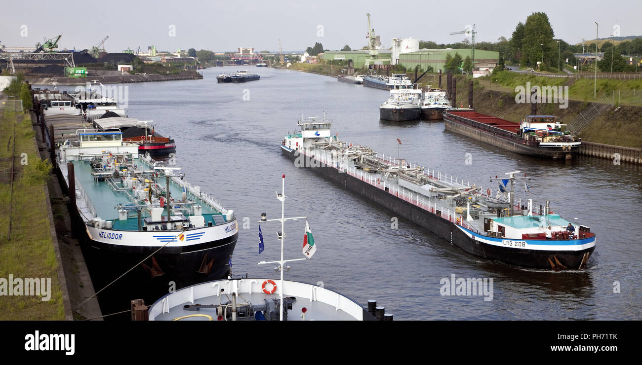 Cargo vessels, inland port in Duisburg, Germany. - Stock Image