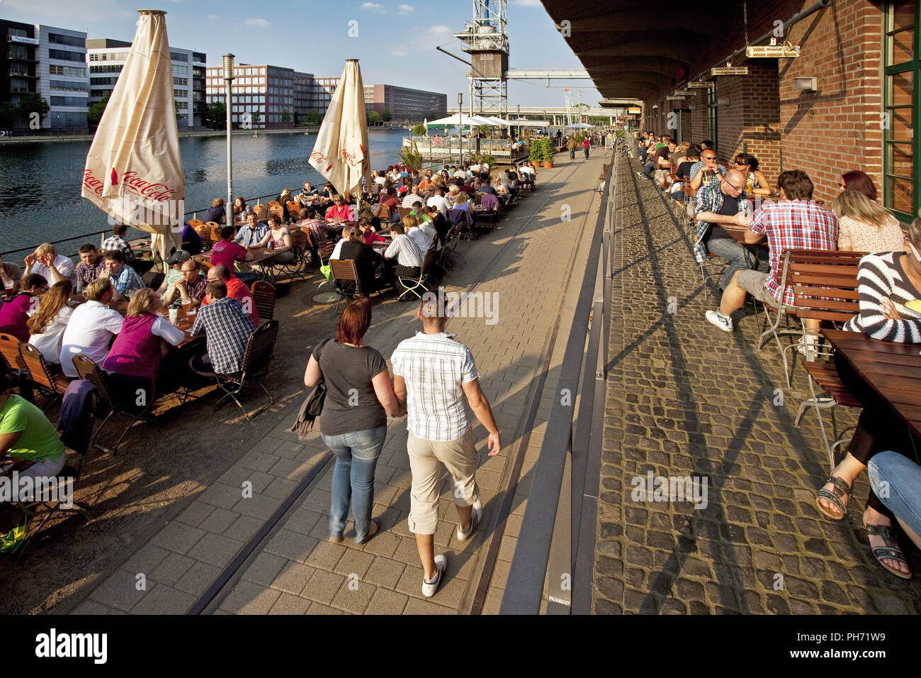 People, gastronomy, Duisburg Inner Harbour,Germany - Stock Image
