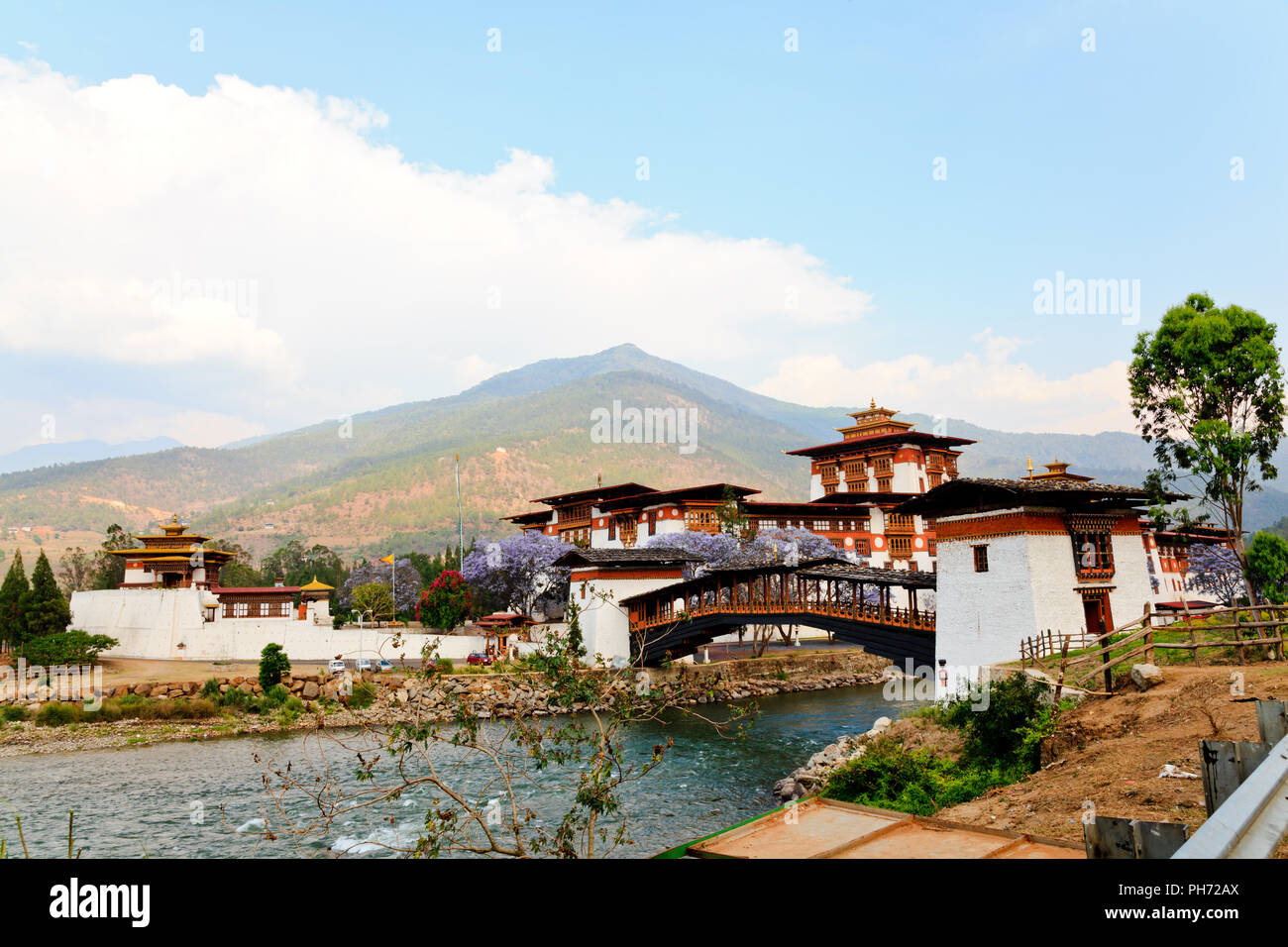 Punakha dzong with wooden cantilever bridge - Stock Image