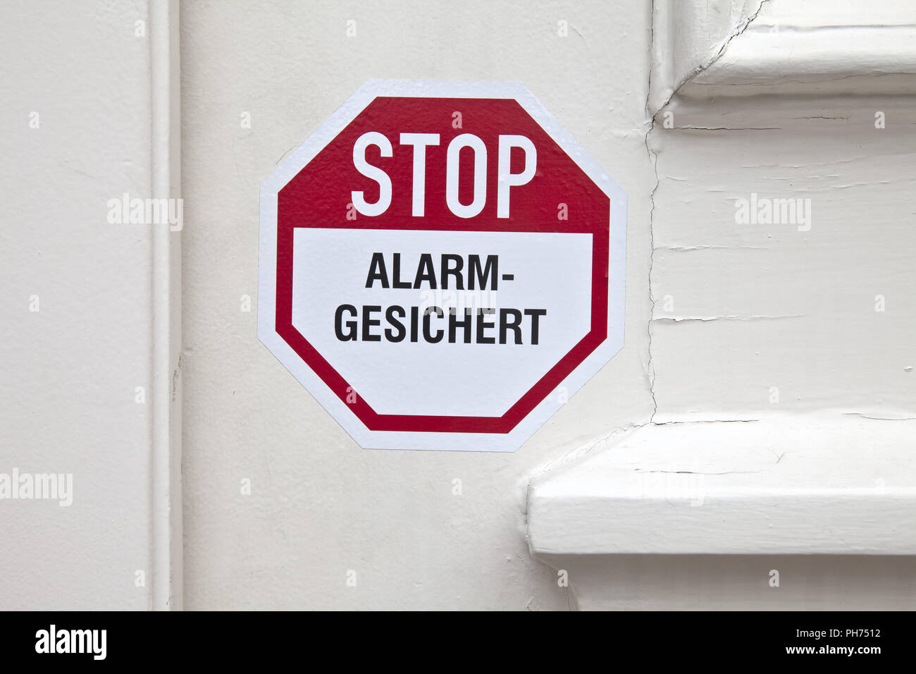 Sticker on the door stop alarm - Stock Image