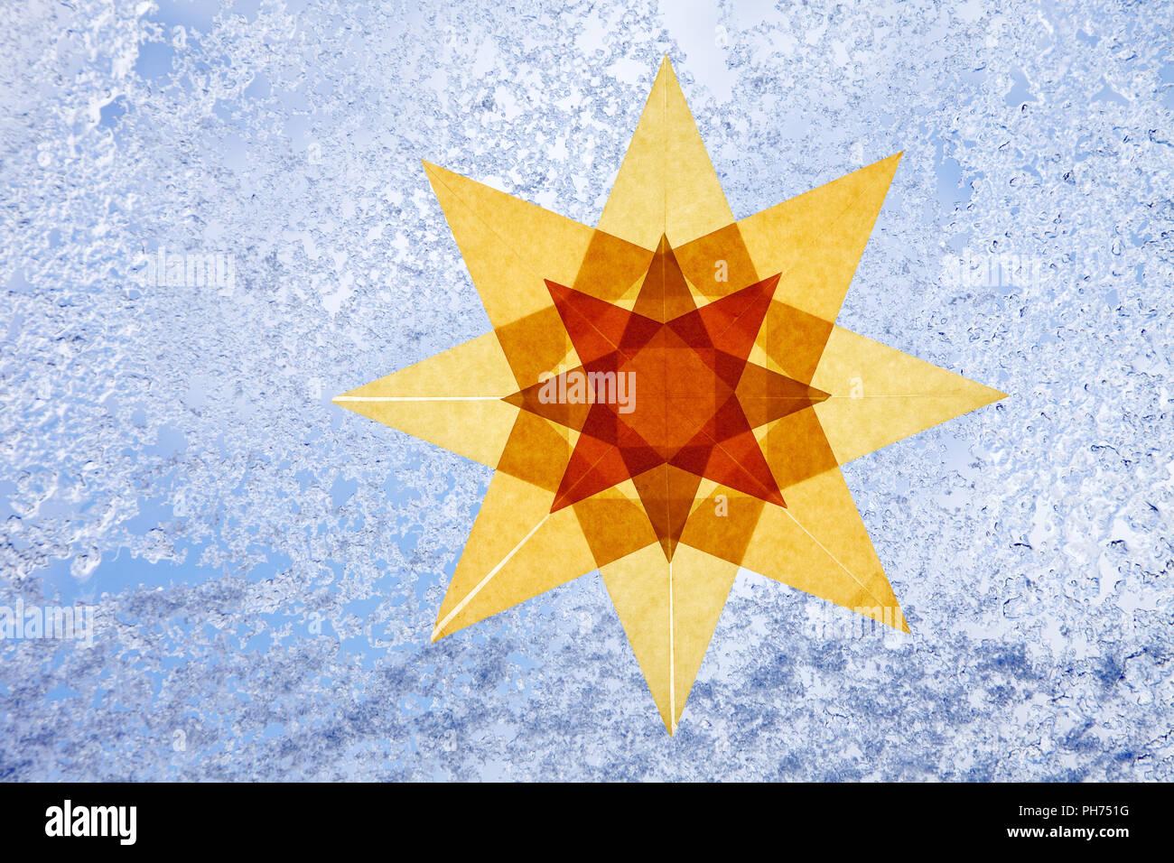 Transparent star, window decoration, wintertime - Stock Image