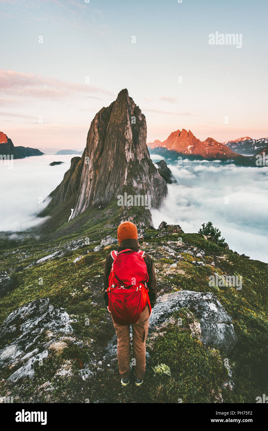 Adventurous woman enjoying sunset Segla mountain hiking solo traveling outdoor in Norway active vacations backpacking healthy lifestyle - Stock Image