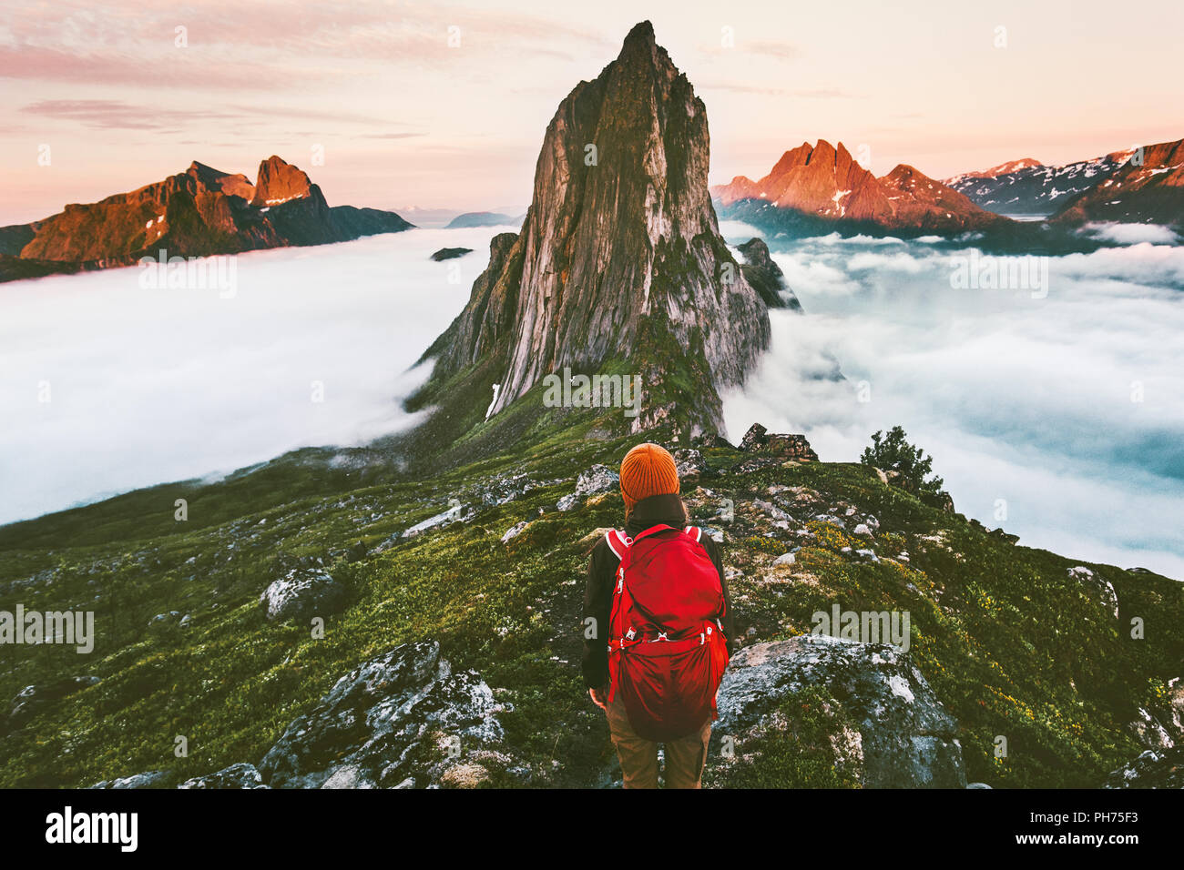 Traveler enjoying sunset Segla mountain  hiking adventure outdoor in Norway active vacations traveling lifestyle - Stock Image