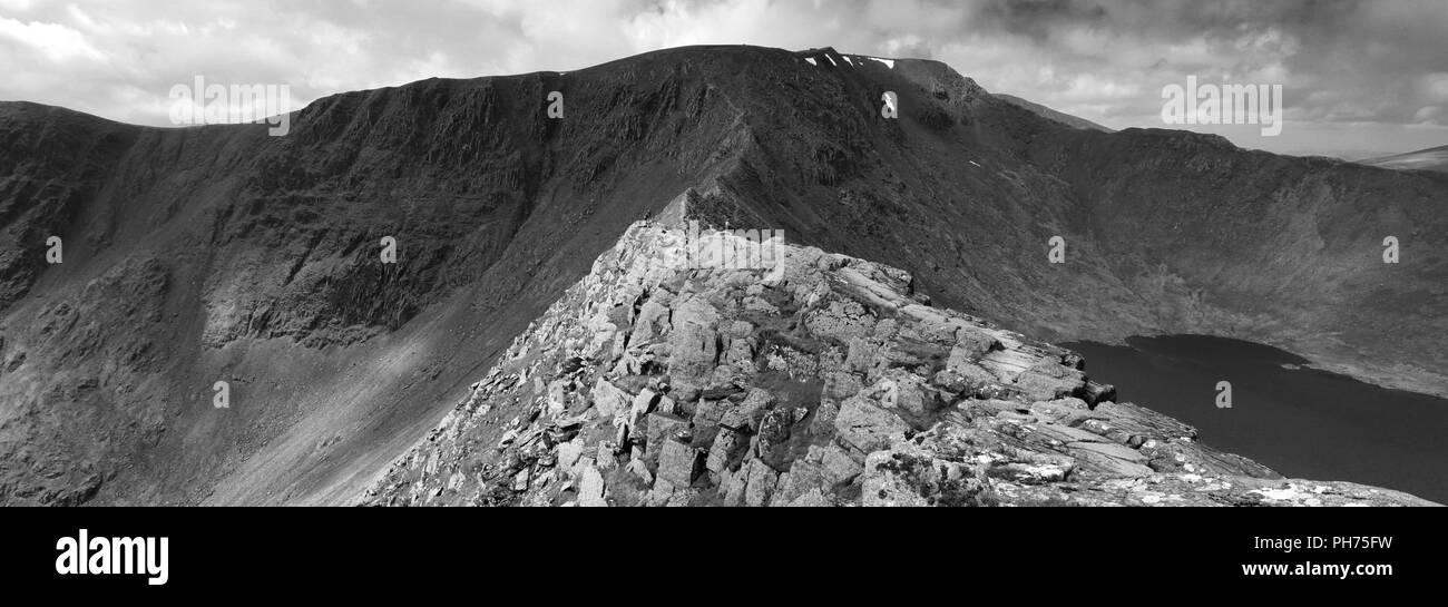 Striding Edge ridge on the way to Helvellyn fell, Lake District National Park, Cumbria, England, UK  Striding Edge is a classic Grade 1 scramble - Stock Image