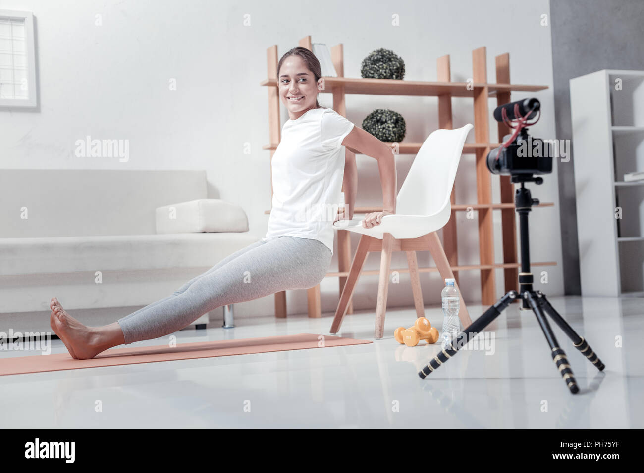 Sporty woman taking video for blog - Stock Image