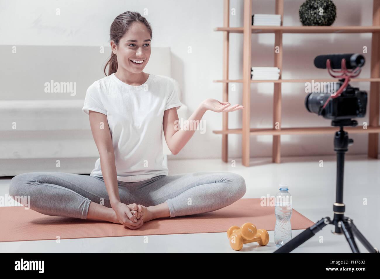 Pleasant woman making video blog - Stock Image