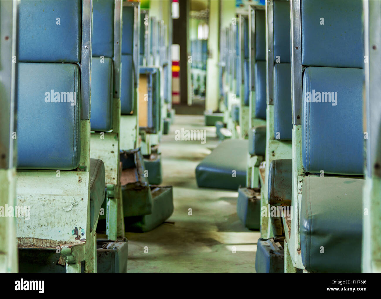 Interior of an empty antiqued train cabin in Thailand. - Stock Image