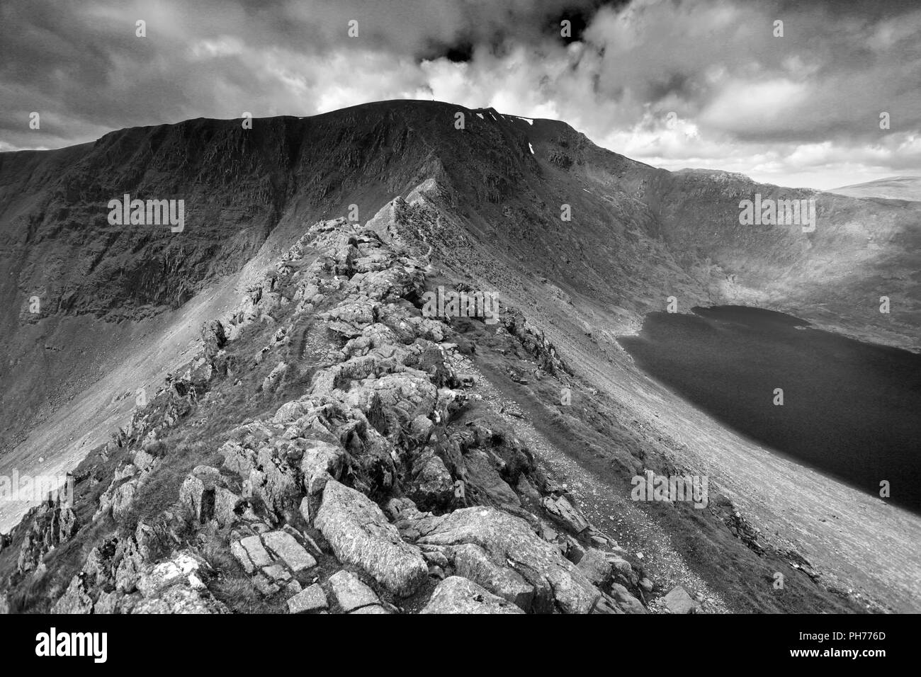 Striding Edge ridge on the way to Helvellyn fell, Lake District National Park, Cumbria, England, UK  Striding Edge is a classic Grade 1 scramble Stock Photo