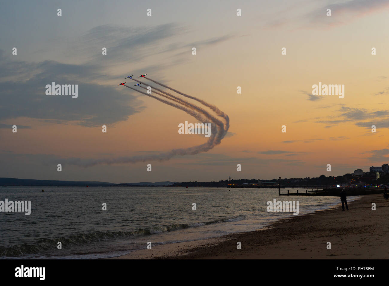 Twister and Fireflies in the evening skies during the dusk performance at the Bournemouth Air Festival 2018 - Stock Image