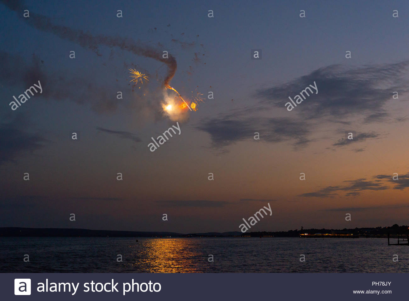 Otto the Helicopter performing at dusk during the Bournemouth Air Festival 2018 - Stock Image