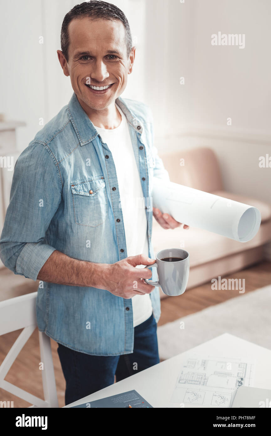 Happy cheerful man working from home - Stock Image