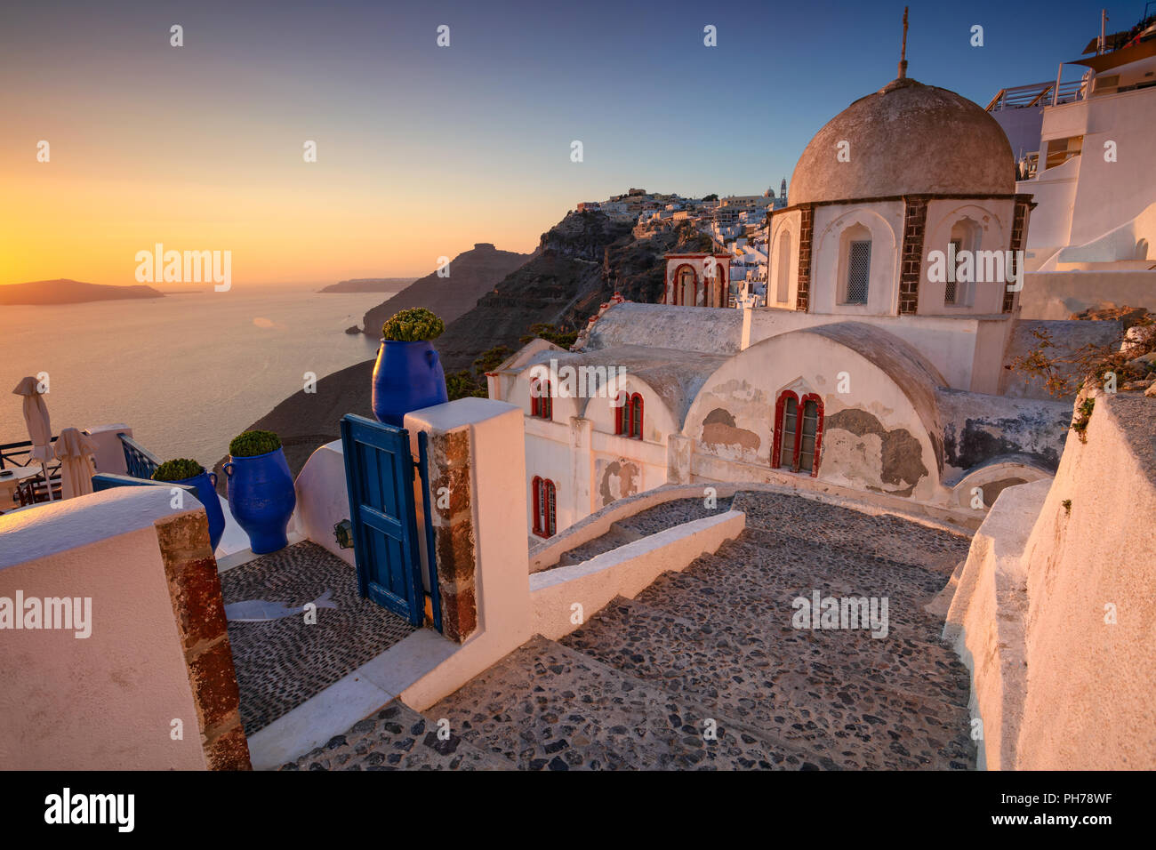 Thira, Santorini. Image of famous village Thira located at one of Cyclades island of Santorini, South Aegean, Greece. - Stock Image