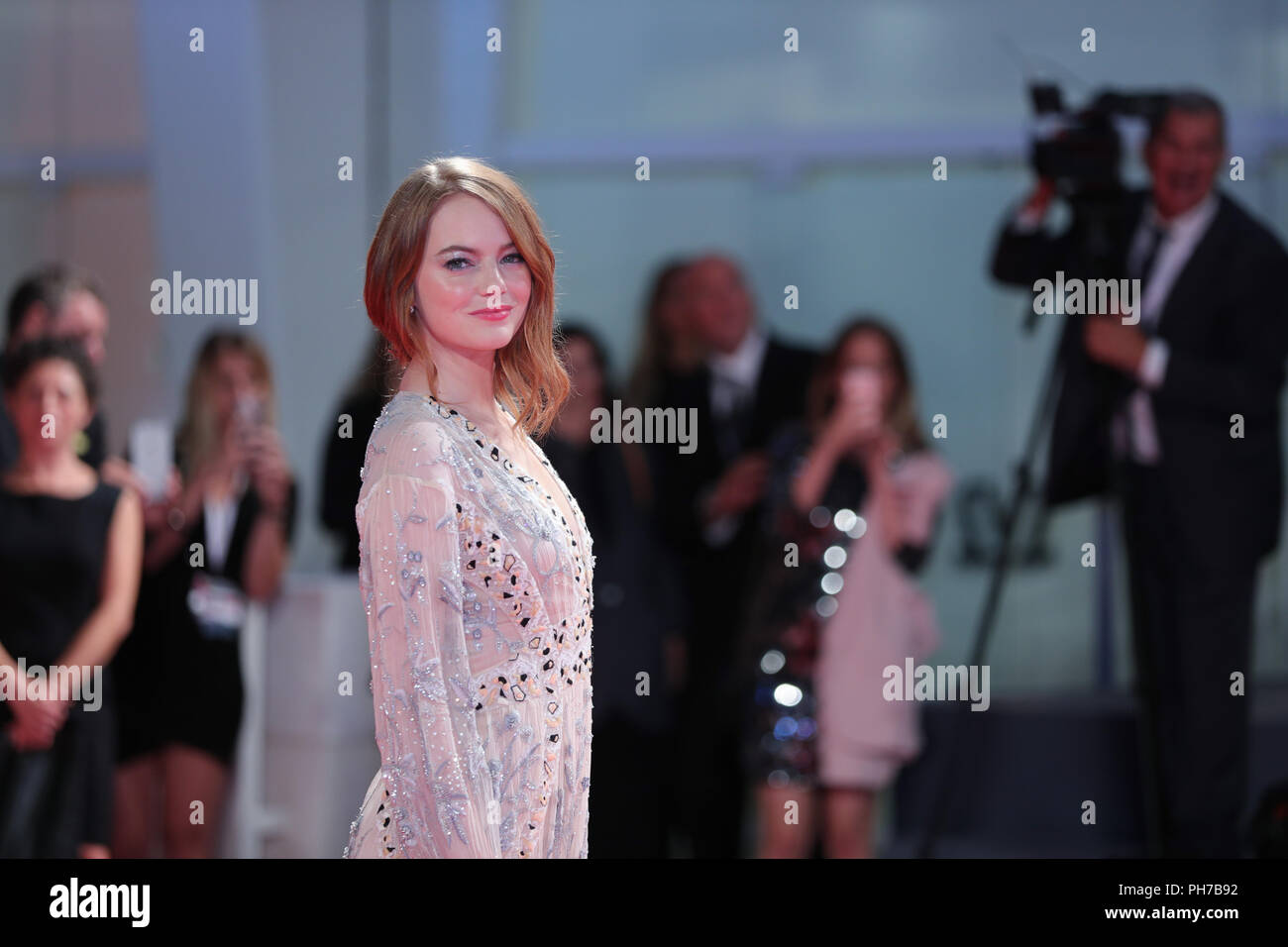 Venice, Italy. 30th Aug, 2018. Actress Emma Stone attends the premiere of film 'The Favourite' at the 75th Venice International Film Festival in Venice, Italy, Aug. 30, 2018. Credit: Cheng Tingting/Xinhua/Alamy Live News - Stock Image