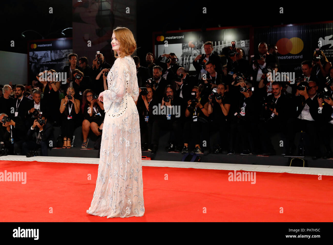 VENICE, ITALY - AUGUST 30: Emma Stone arrives at the 'The Favourite' premiere during the 75th Venice Film Festival at the Palazzo del Cinema on August 30, 2018 in Venice, Italy.  Credit: John Rasimus/MediaPunch  ***FRANCE, SWEDEN, NORWAY, DENARK, FINLAND, USA, CZECH REPUBLIC, SOUTH AMERICA ONLY*** - Stock Image