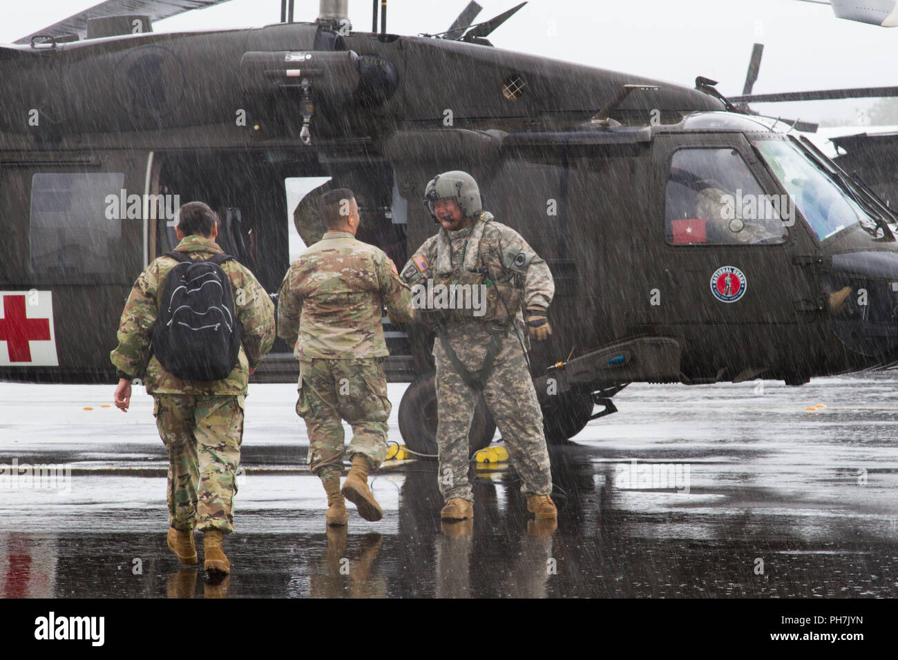 Hilo, Hawaii, USA. 30th Aug, 2018. Brig. Gen. Kenneth Hara, Deputy Adjutant General, Hawaii Army National Guard and Joint Task Force 5-0 commander, lands at Hilo International Airport, Hilo, Hawaii, to conduct briefings to Hawaii National Guard and Active Duty Soldiers responding to Hurricane Lane on Aug. 27, 2018. Local authorities and the state of Hawaii, through JTF 5-0, requested HH-60M Black Hawk helicopters with hoist capability to assist local authorities with recovery operations on the Isle of Hawaii. JTF 5-0 is a joint task force led by a dual status commander that - Stock Image