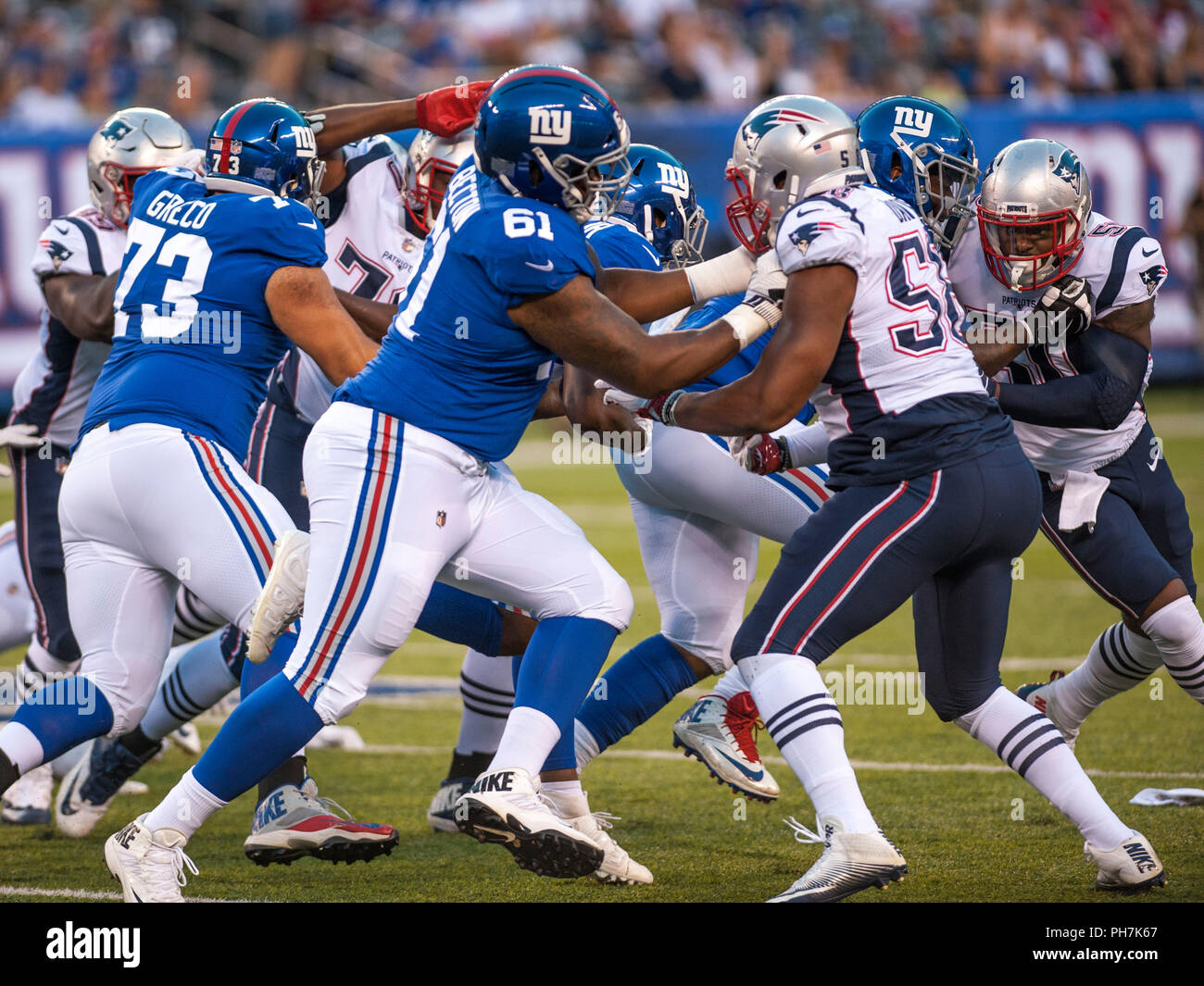 August 31, 2018 - East Rutherford, New Jersey, U.S. - New York Giants offensive tackle Nick Becton (61) blocks New England Patriots defensive end Keionta Davis (58) during a preseason game between the New England Patriots and the New York Giants at MetLife Stadium in East Rutherford, New Jersey. Duncan Williams/CSM - Stock Image