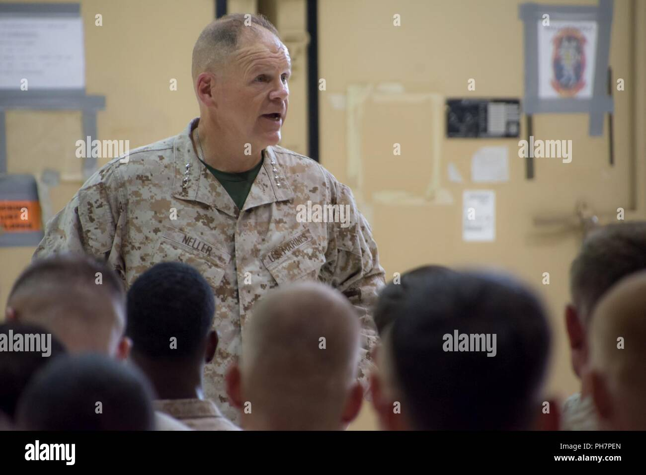 The 37th Commandant of the Marine Corps, Gen. Robert Neller, visits Marines deployed to Al Udeid Air Base, Qatar, June 26, 2018. VMAQ-2, the last squadron of EA-6B Prowler aircraft, is presently deployed here and will be deactivated in October 2018. Stock Photo